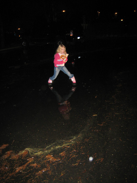 Little girls with boots on get to go stomping in puddles!