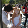 Ilia's getting her face painted.