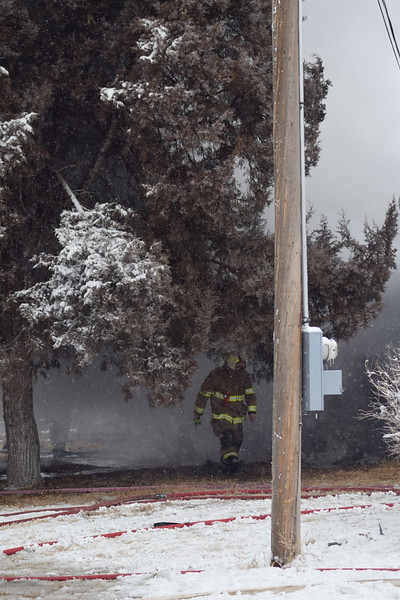 Firefighter on scene at a house fire in Iliff Thursday morning, Feb. 1, 2018.