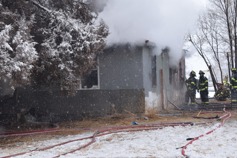 Firefighters put water on a fire inside an Iliff home Thursday morning, Feb. 1, 2018.