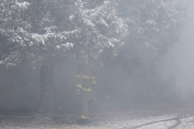 Sterling firefighter at the scene of a house fire in Iliff Thursday, Feb. 1, 2018.