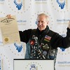 Illinois Gov. Bruce Rauner holds up a proclamation marking Illinois' Bicentennial at an event held Dec. 3, 2017, in Chicago at Navy Pier. Illinois REALTORS® was recognized for its work to commemorate the birthday at the event. Photo: Matt Difanis