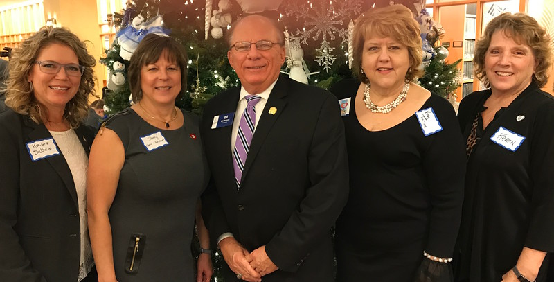 Kristie DeBrun, Sheryl Grider Whitehurst, Ed Neaves, Vicky Turner and Karen Stailey-Lander take part in a reception honoring Illinois' 200th birthday in Springfield on Sunday, Dec. 3, 2017.