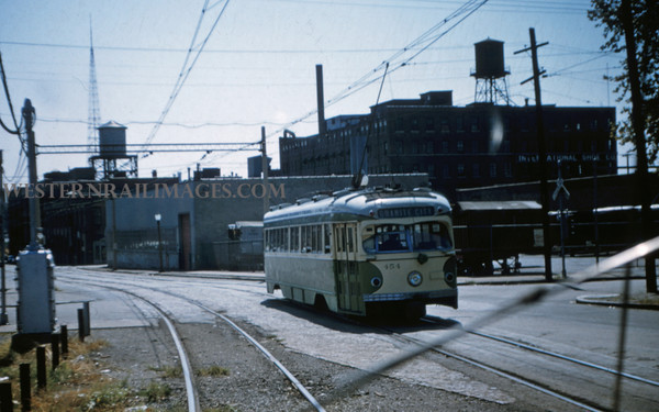 ITS 82 - Sep 11 1955 - PCC 454 rolling off of highline onto 11th street St Louis MO
