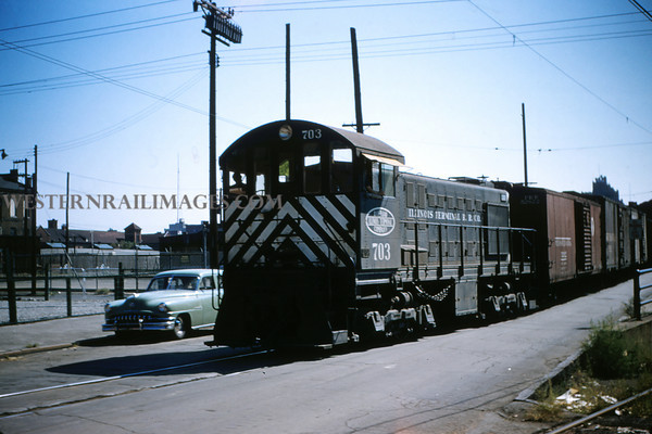 ITS 90 - Sep 11 1955 - Illinois Terminal switcher No  703 near subway entrance on switching line 11th St