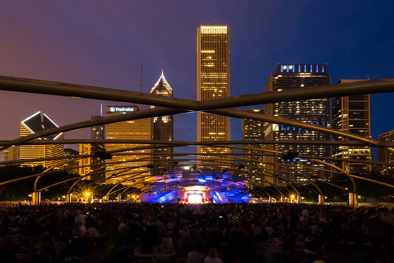 A crowd gathers under the Pritzker Music Pavilion waiting for a concert to resume after the brief intermission. Chicago, IL<br /> <br /> IL-140809-0097