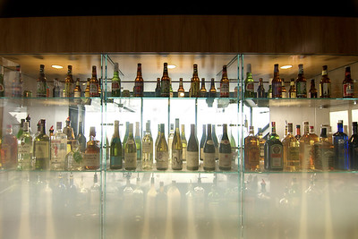 Bottles on glass shelves at the bar at 360 Chicago on the top floor of the John Hancock building in downtown Chicago, IL on Monday, August 10, 2015. Copyright 2015 Jason Barnette