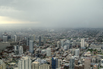 A summer thunderstorm moves across the city, viewed from 360 Chicago at the John Hancock building, in downtown Chicago, IL on Monday, August 10, 2015. Copyright 2015 Jason Barnette