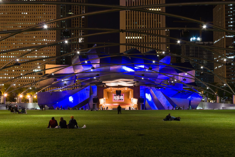 The Pritzker Pavilion lawn is an inviting place to enjoy a warm summer night watching a performance, admiring the city skyline or just relaxing wtih friends. Chicago, IL<br /> <br /> IL-080601-0410
