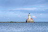The Chicago Lighthouse on a rock jetty protecting the harbor in Chicago, IL on Monday, August 10, 2015. Copyright 2015 Jason Barnette