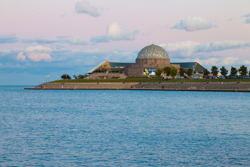 The sky behind the Adler Planetarium glows with pink hues during sunset. Chicago, IL<br /> <br /> IL-091004-0055