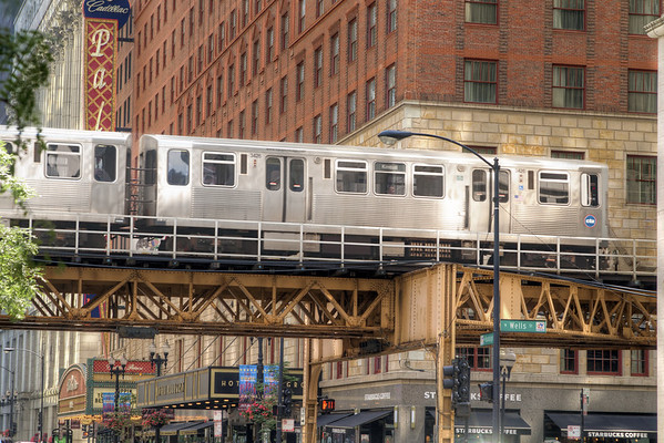 A train car moves along the elevated railway in downtown Chicago, IL on Monday, August 10, 2015. Copyright 2015 Jason Barnette