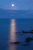 Moonrise over Lake Michigan. On the distance, the light from the Four Mile Crib glows. Chicago, IL<br /> <br /> IL-091004-0068