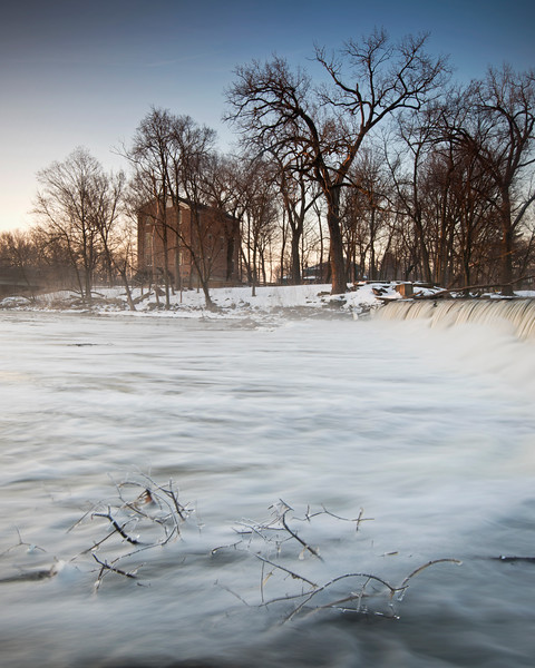 FBW 022<br /> <br /> The icy waters of Salt Creek flow over the dam at Graue Mill on a cold winter day at sunrise.