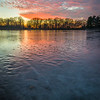 HL 003<br /> <br /> The colors of a winter sunset reflect off the frozen surface of Herrick Lake.  Herrick Lake Forest Preserve, DuPage County, Illinois.