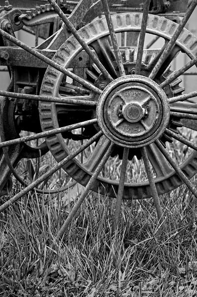 KC 011<br /> <br /> Iron wheel detail of 1890's farm implement.  Kline Creek Farm Forest Preserve, DuPage County, Illinois.
