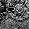 KC 011<br /> <br /> Iron wheel detail of 1890's farm implement.  Kline Creek Farm Forest Preserve, DuPage County, Illinois.