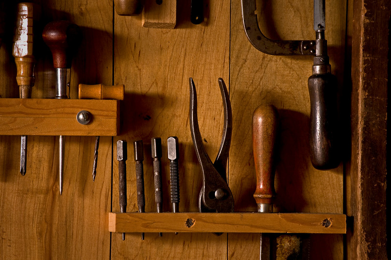 KC 005<br /> <br /> Hand tools neatly organized in racks in the woodworking shop.  Kline Creek Farm Forest Preserve, DuPage County, Illinois.