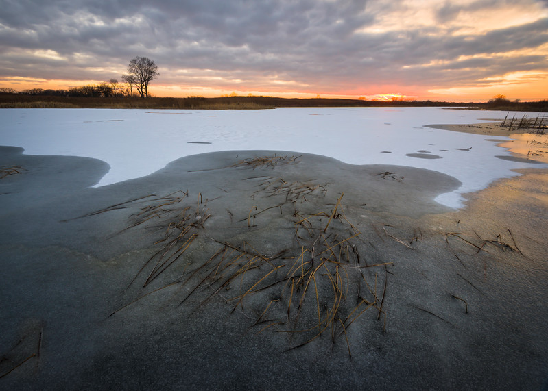 SBP 147<br /> <br /> A winter sunset over a frozen wetland marsh at Springbrook Prairie Nature Preserve, DuPage County, Illinois.
