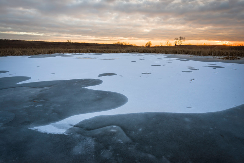 SBP 145<br /> <br /> A winter sunset over a frozen wetland marsh at Springbrook Prairie Nature Preserve, DuPage County, Illinois.
