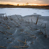 SBP 143<br /> <br /> A winter sunset over a frozen wetland marsh at Springbrook Prairie Nature Preserve, DuPage County, Illinois.