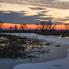 SBP 151<br /> <br /> A winter sunset over a frozen wetland marsh at Springbrook Prairie Nature Preserve, DuPage County, Illinois.