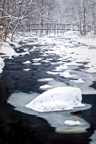 WFG 011<br /> <br /> The icy waters of Sawmill Creek flow under a footbridge at Waterfall Glen Forest Preserve, DuPage County, Illinois.