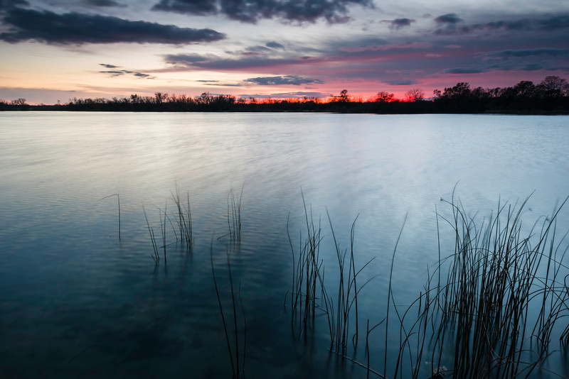 WB 001<br /> <br /> Sunset over Deep Quarry Lake.  West Branch Forest Preserve, DuPage County, Illinois.