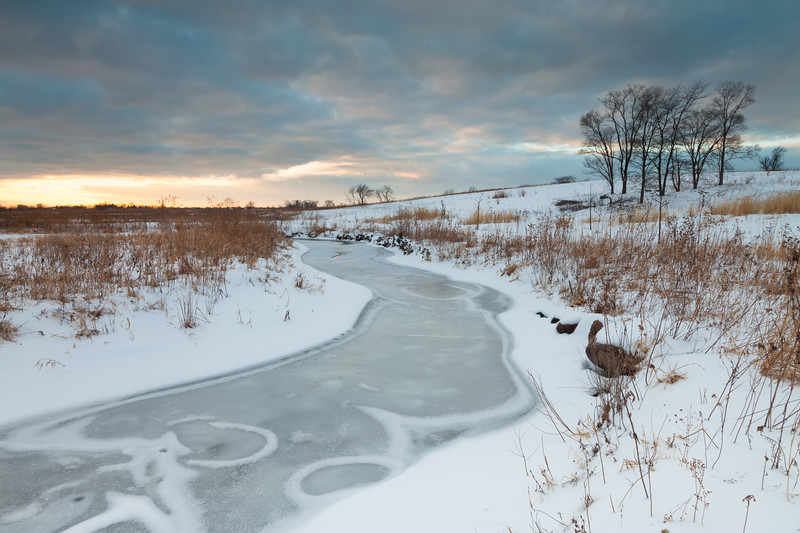 Ice and snow patterns form over Springbrook Creek. Naperville, IL<br /> <br /> IL-101222-0002