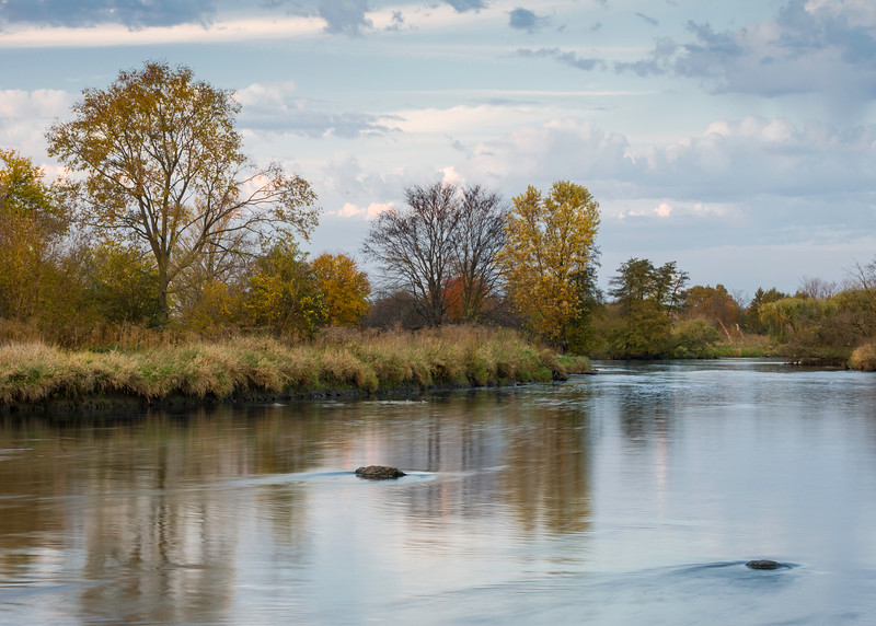 DRCP 002<br /> <br /> Autumn colors reflect in the smooth surface of the DuPage River at sunset.  DuPage River Confluence Preserve, Will County, Illinois.