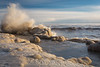 Waves explode as they hit an ice shelf on the shore of Lake Michigan. Highland Park, IL<br /> <br /> IL-150215-0103