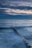 Waves break agains a frozen groin in Openlands Lakeshore Preserve. Highland Park, IL<br /> <br /> IL-100109-0025