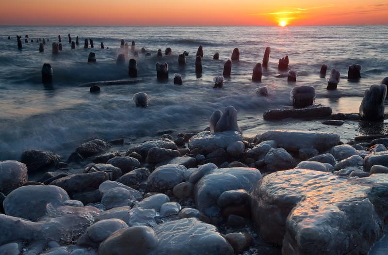 Sunrise over the frozen lakeshore. Highland Park, IL<br /> <br /> IL-091212-0023