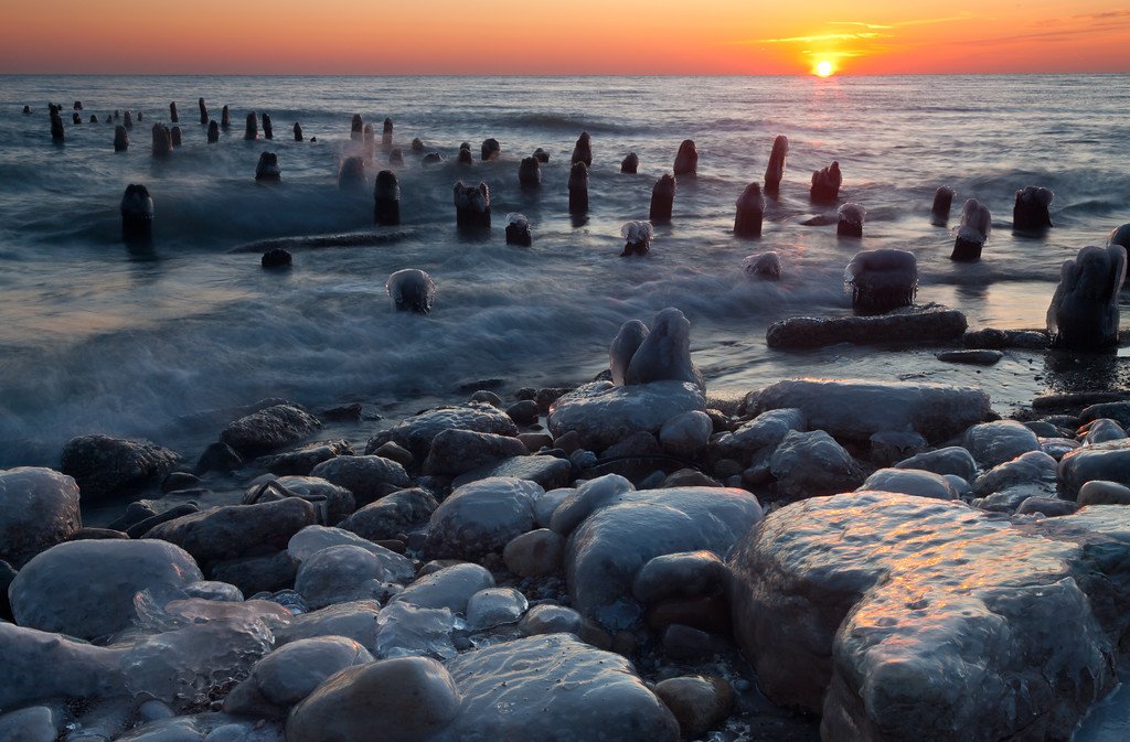 Sunrise over the frozen lakeshore. Highland Park, IL<br /> <br /> IL-091212-0023