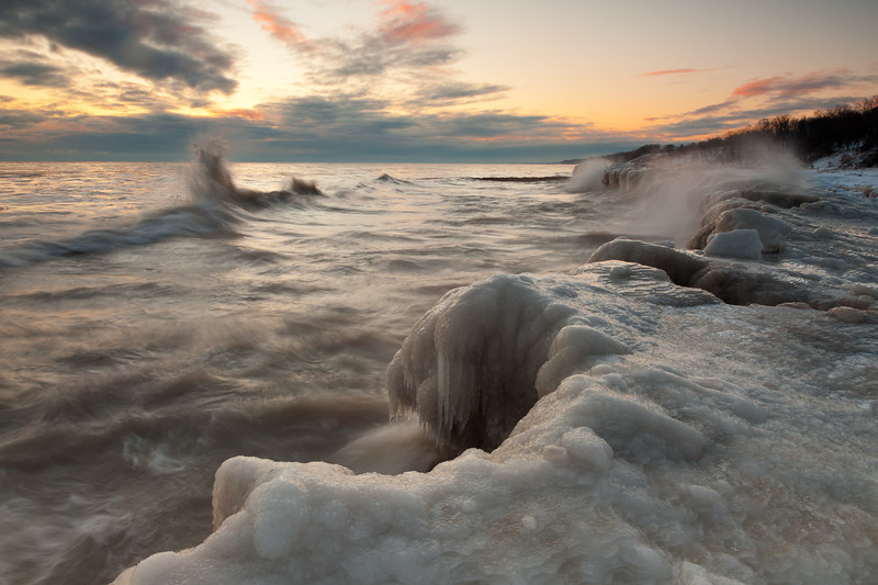 Violent waves crash against the ice shores of Lake Michigan. Highland Park, IL<br /> <br /> IL-100109-0051