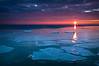 OLP 019                    A winter sunrise over plates of ice floating in Lake Michigan, Openlands Lakeshore Preserve, Fort Sheridan, IL.