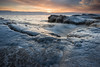 OLP 034   Sunrise over the winter shelf ice that has built up along the Lake Michigan shoreline at Openlands Lakeshore Preserve, Fort Sheridan, Illinois.