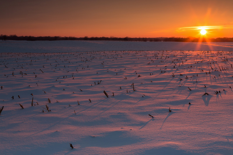 Sunset light paints the snow covered farmland on a chilly winter afternoon. Millbrook, IL<br /> <br /> IL-140202-0254