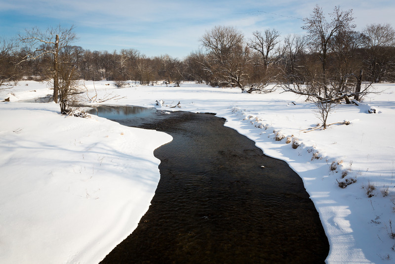 View of Big Rock Creek as it winds its way though the snow covered terrain. Plano, IL<br /> <br /> IL-140202-0007