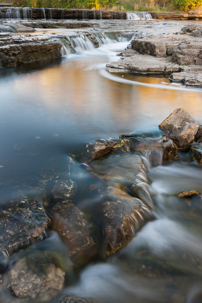 Fall color reflects on the flowing water of Prairie Creek. Wilmington, IL<br /> <br /> IL-071020-0038