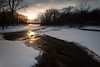 The setting sun reflects on the open water of Prairie Creek. Wilmington, IL<br /> <br /> IL-100110-0018