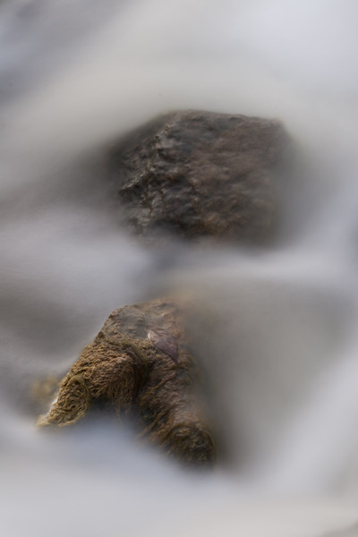 A pair of rocks surface from the turbulent waters of Prairie Creek. Wilminton, IL<br /> <br /> IL-071020-0076