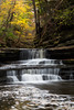 Autumn color along the Giant's Bathtub waterfall in Matthiesen State Park. Lasalle County, IL<br /> <br /> IL-171025-0011