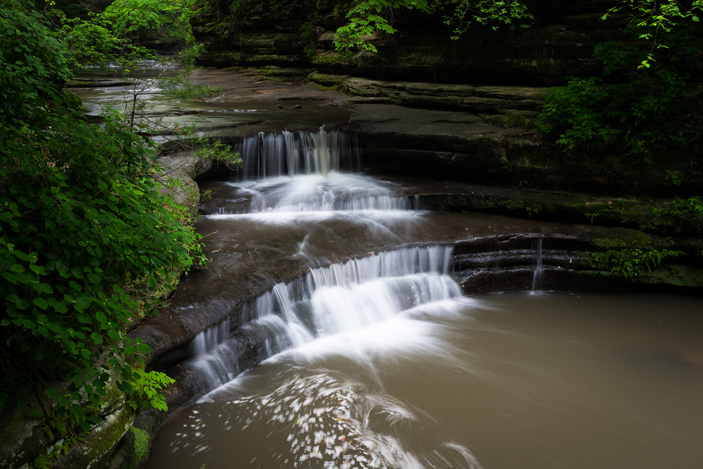 A heavy flow of water can be seen on the Giants Bathtub following a rainy night. Lasalle County, IL<br /> <br /> IL-160604-0096