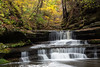 Autumn color along the Giant's Bathtub waterfall in Matthiesen State Park. Lasalle County, IL<br /> <br /> IL-171025-0008