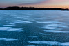 Sunset colors in the sky contrast agains the cold blue ice of Lake Defiance. Antioch, IL<br /> <br /> IL-080120-0127