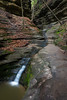 This small waterfall is the outflow of the waterfall in the French Canyon. The entrance to the canyon is narrow and one has to climb through the running water to enter the canyon. Lasalle County, IL<br /> <br /> IL-130504-0205