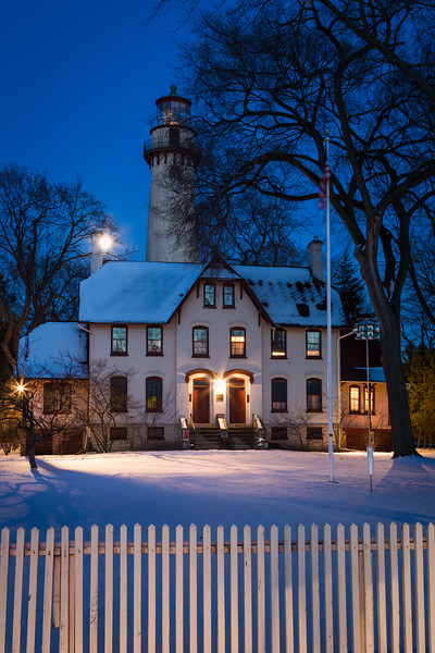 Grosse Point Light Station as seen from the street. The moon is rising behind the lighthouse. Evanston, IL  IL-130224-0012