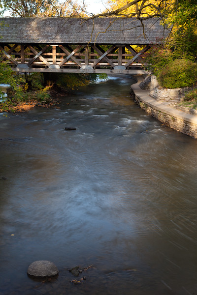 The DuPage River rolls over the rocky bottom as it passes through downtown Naperville. Naperville, IL<br /> <br /> IL-111010-0070