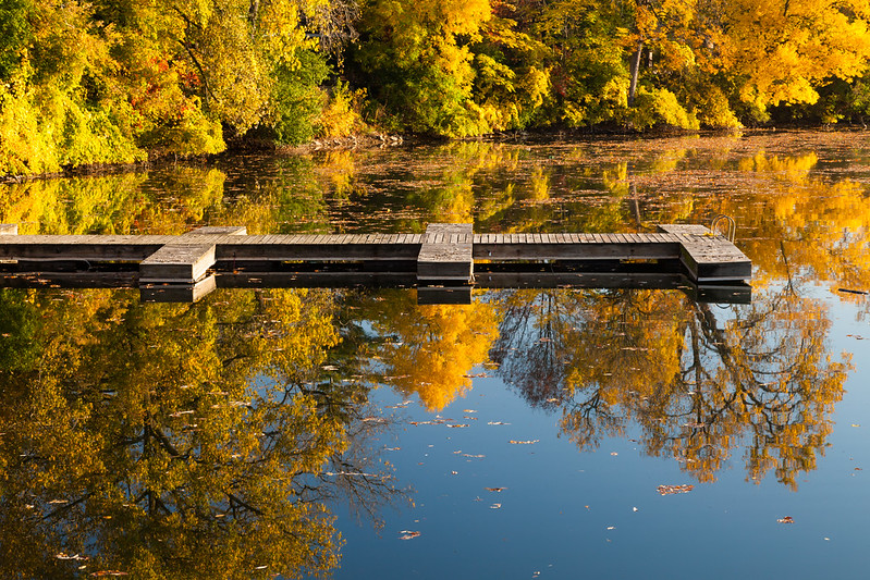 The paddle boat pier on Quarry Lake sits empty on an early fall morning. Naperville, IL<br /> <br /> IL-111009-0060